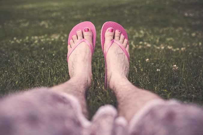 man feet legs relaxing